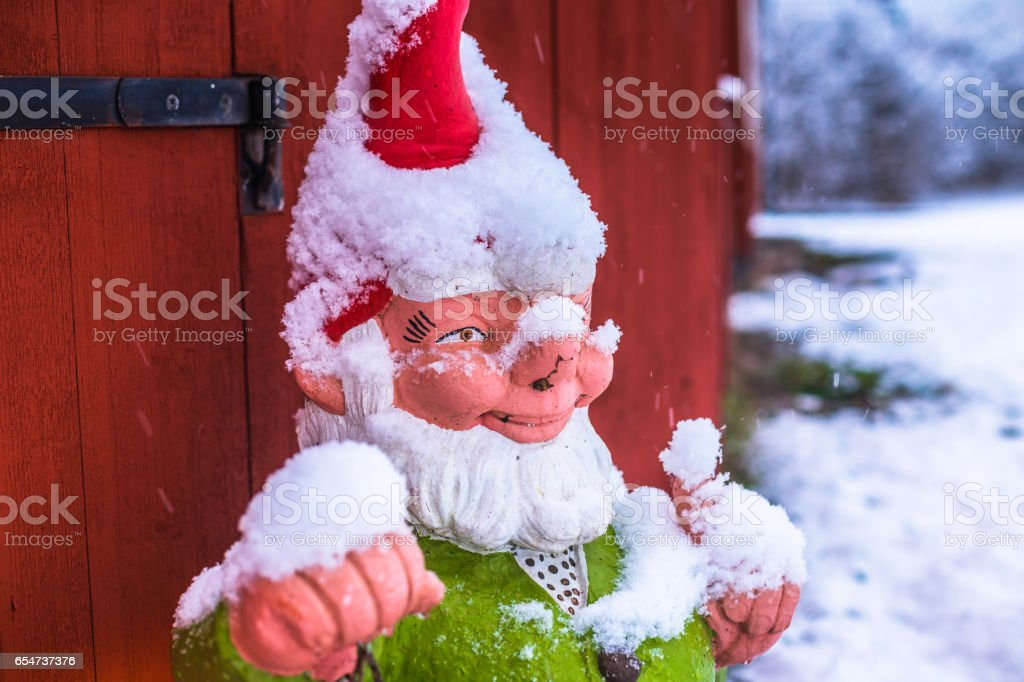 December 10, 2016: A Christmas scandinavian elf covered in snow in Sigtuna in winter, Sweden stock photo