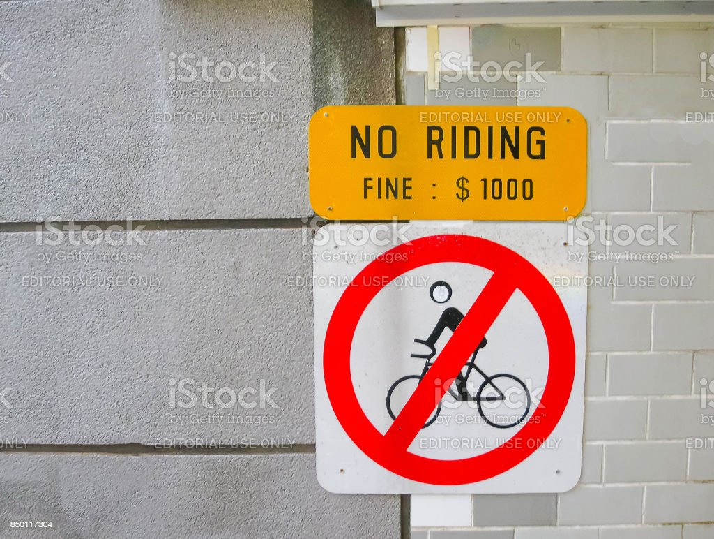 December 24, 2008: 'No Riding' sign on a street in Singapore stock photo