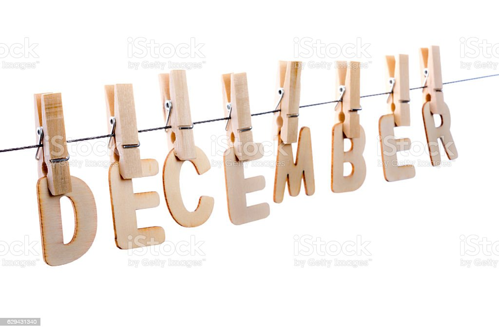 December in wooden letters on clothesline stock photo