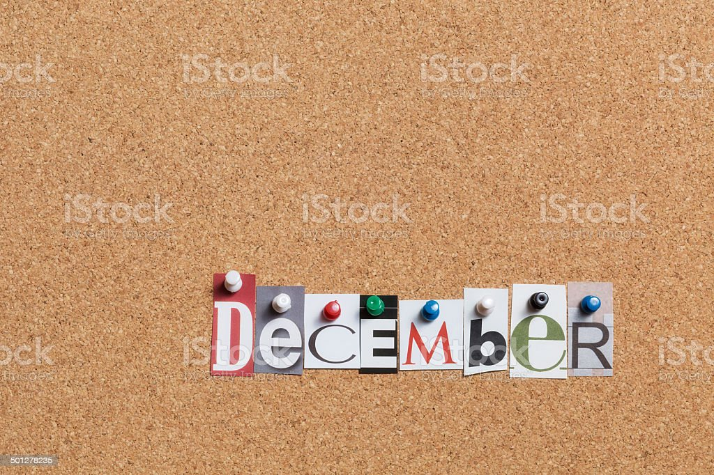 December pinned on bulletin cork board royalty-free stock photo