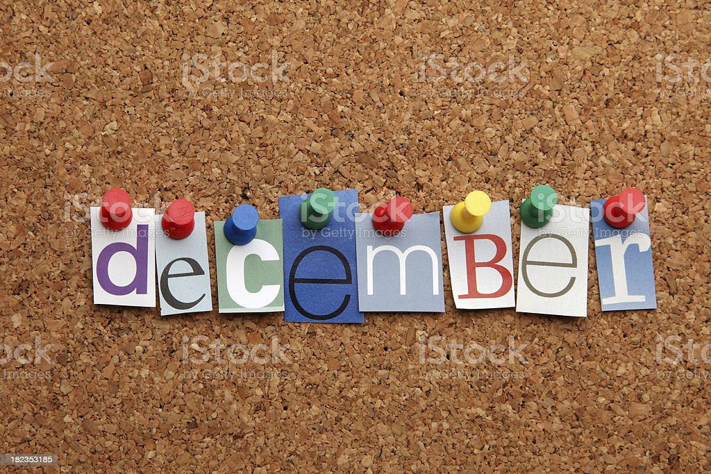December pinned on noticeboard stock photo