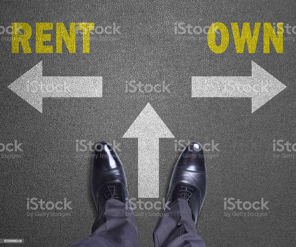 Decision at a road - Rent or Own stock photo