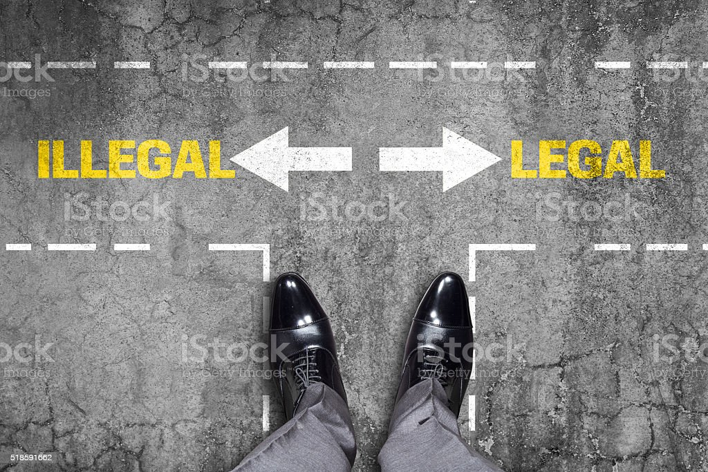 Decision at a wall - Illegal or Legal stock photo