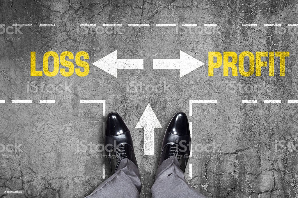 Decision at a wall - Loss or Profit stock photo