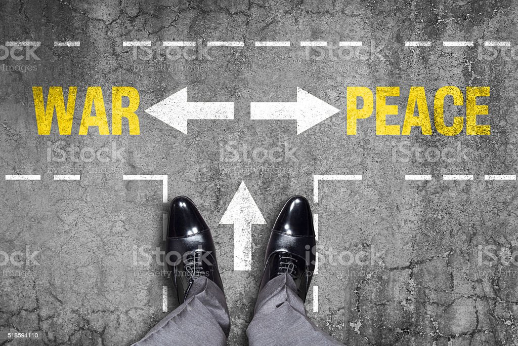 Decision at a wall - War or Peace stock photo