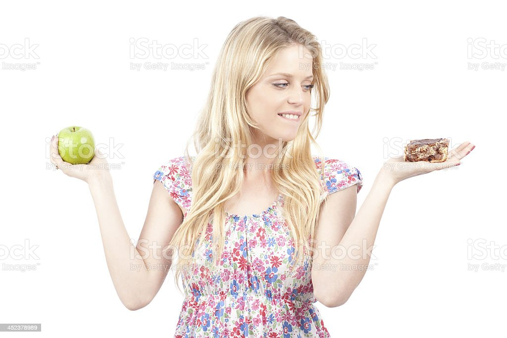 Decision- cake or an apple? royalty-free stock photo