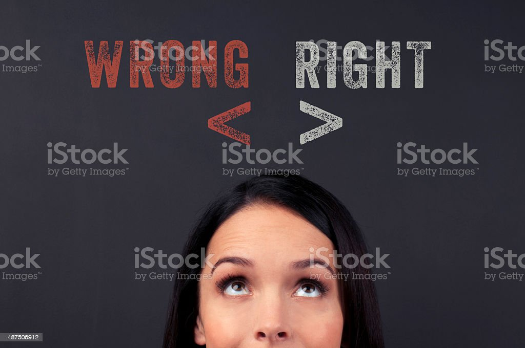 Decision concept. Woman looking up at right and wrong. T stock photo