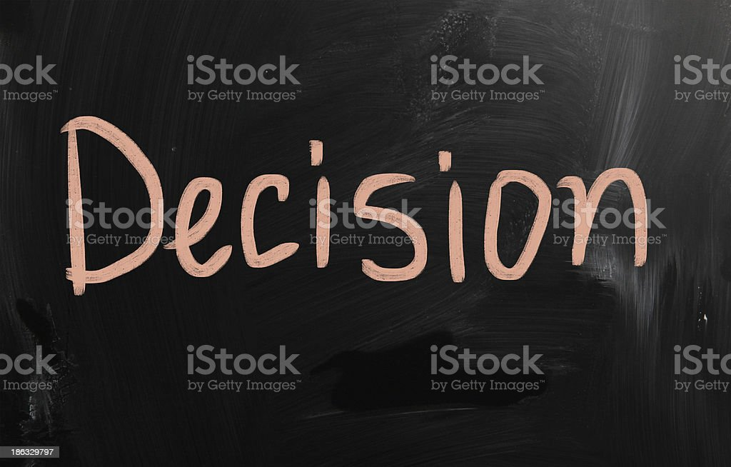 'Decision' handwritten with white chalk on a blackboard royalty-free stock photo