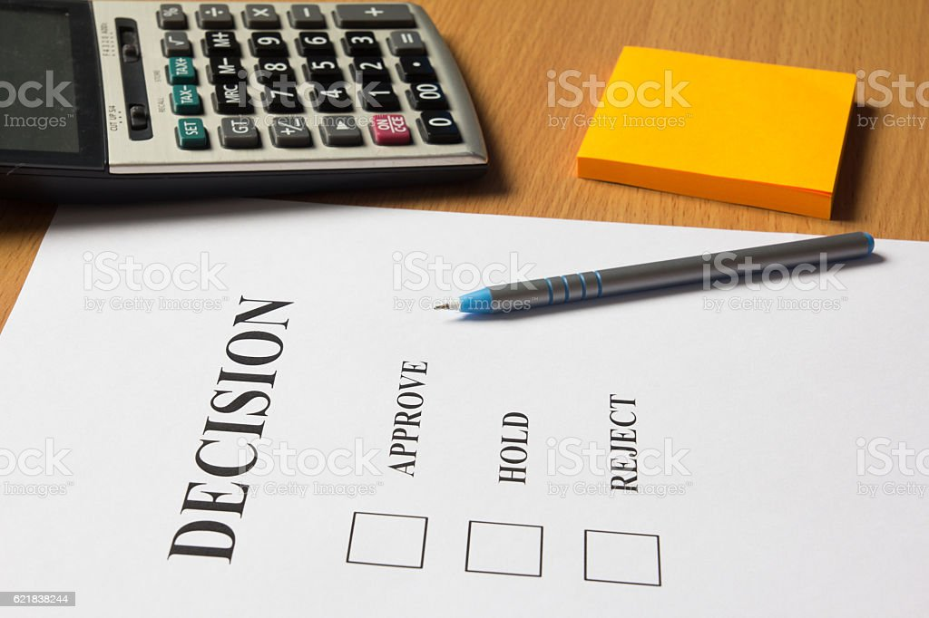 Decision paper (approve, hold, reject) with pen, calculator, note stock photo