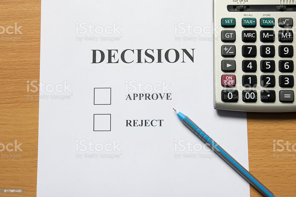 Decision paper (approve, reject) with pen, calculator stock photo