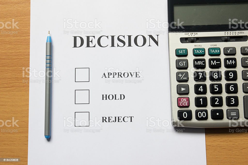 Decision paper (approve, hold, reject) with pen, calculator stock photo