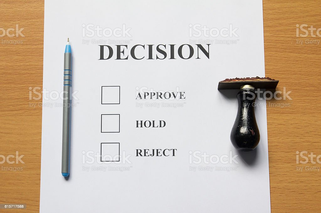 Decision paper (approve, hold, reject) with pen, rubber stamp stock photo