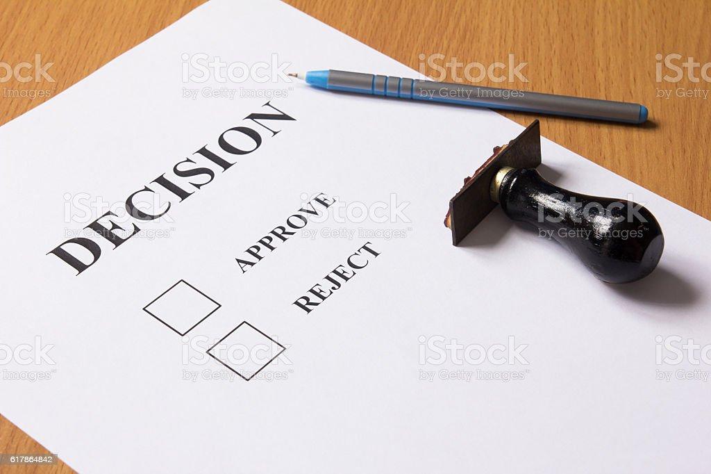 Decision paper (approve, reject) with pen, rubber stamp stock photo