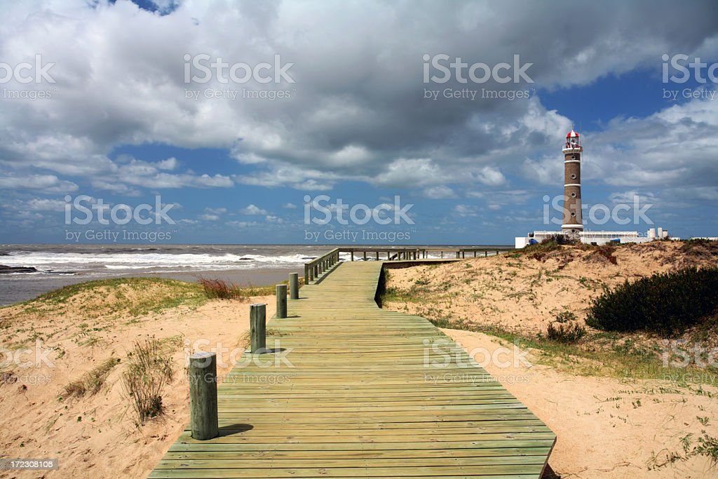 A deck and a lighthouse at Punta del Este in Jose Ignacio stock photo