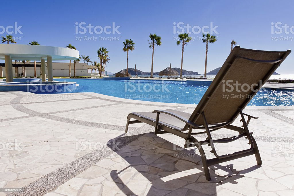 Deck Chair at Swimming Pool royalty-free stock photo