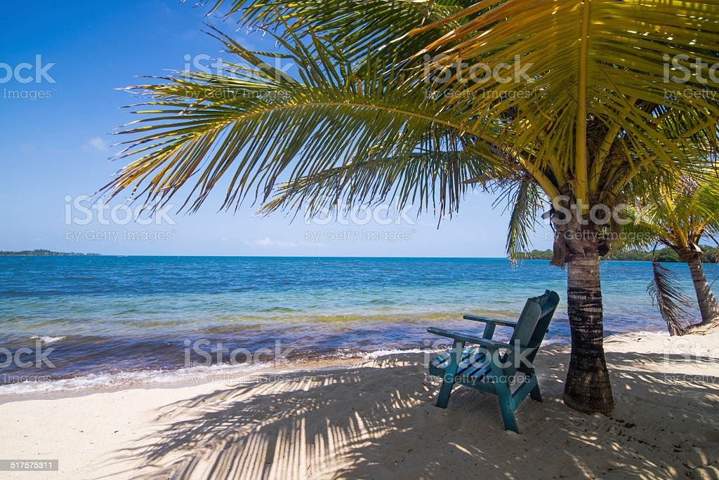 Deck chair on Tropical Beach stock photo