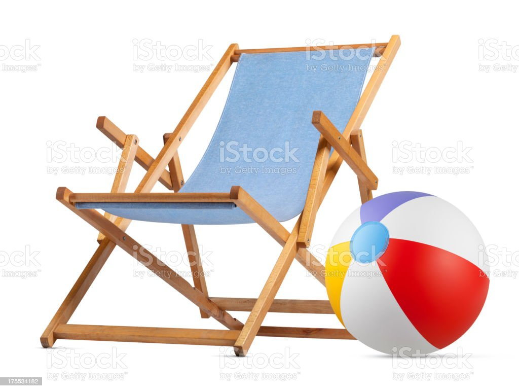 Deck chair with beach ball stock photo