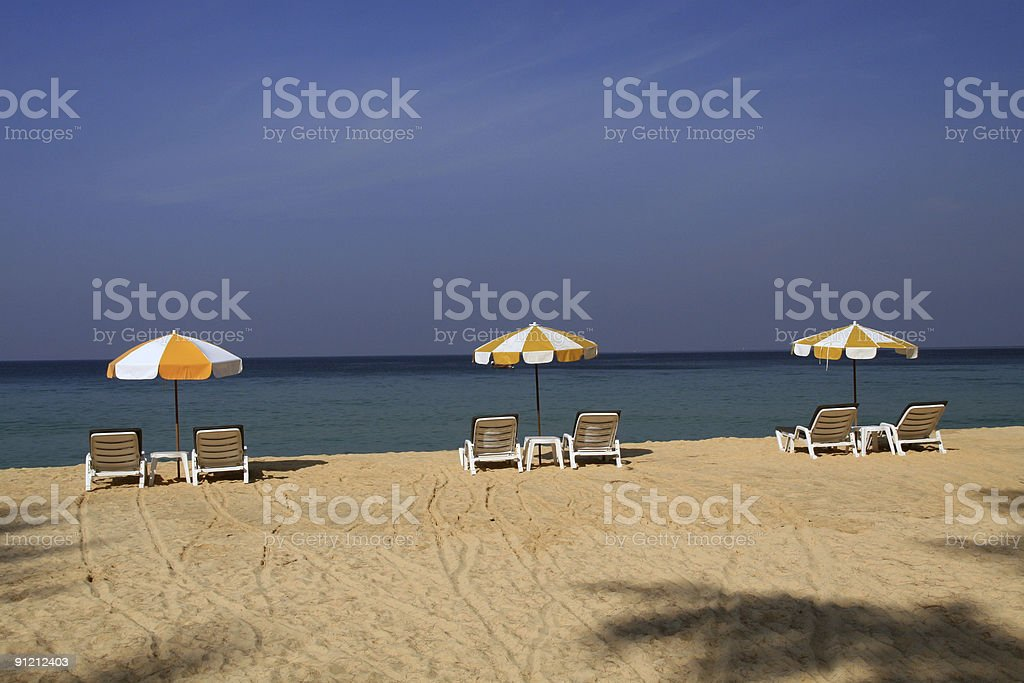 Deserted Beach With Sunshade and Chairs stock photo