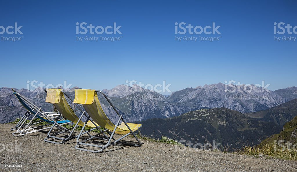 deck chairs at alpine lookout royalty-free stock photo