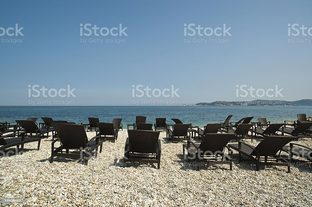 Deck chairs at the beach stock photo