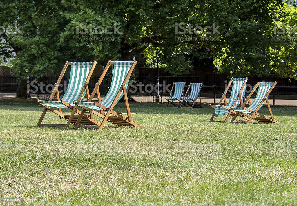 Deck chairs in Green Park, London stock photo