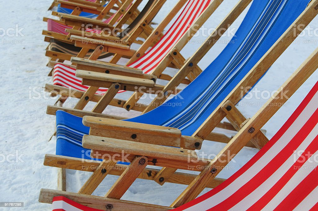 Deck chairs in the snow royalty-free stock photo