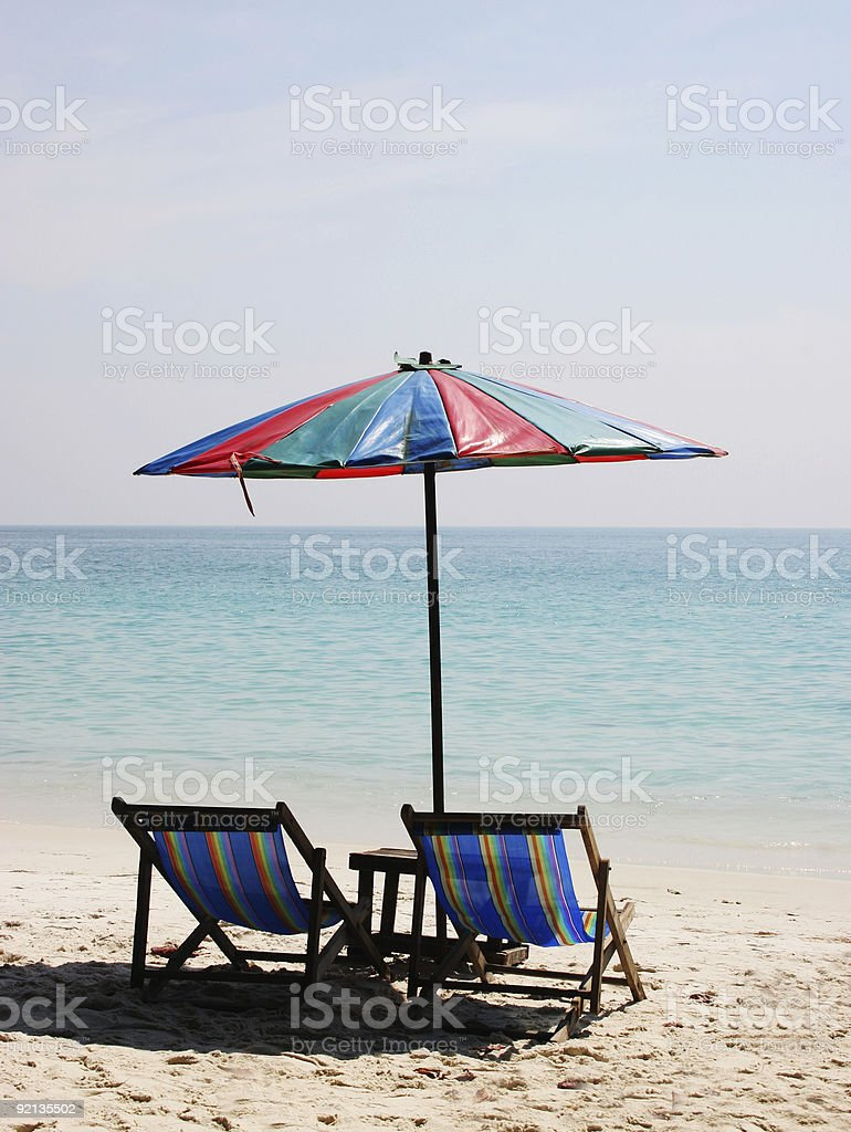 Deck chairs on a white sandy beach royalty-free stock photo