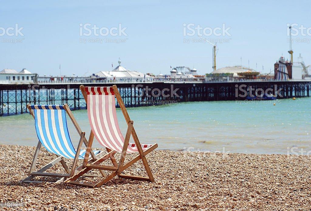 deck chairs on the beach Brighton England stock photo