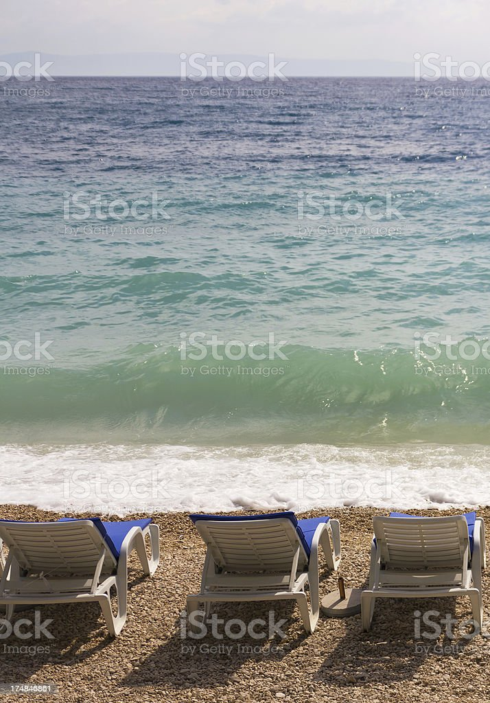 Deck chairs on the beach royalty-free stock photo