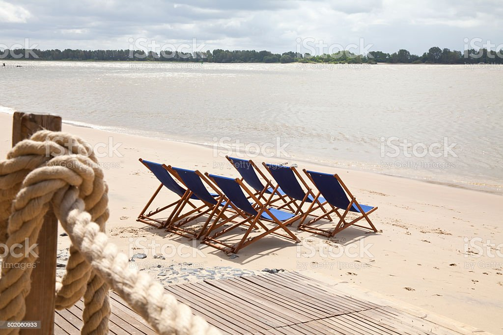 Deck chairs on the beach stock photo