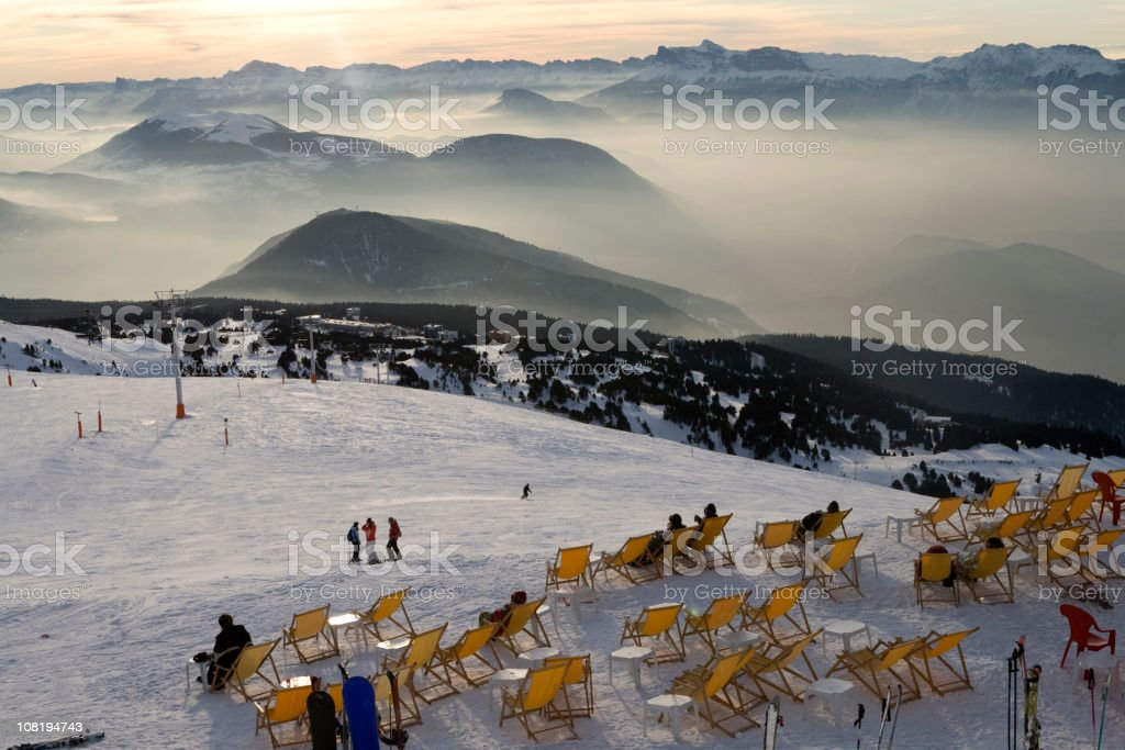 Deck Chairs Sitting Out in Snow on Ski Hill Mountain royalty-free stock photo