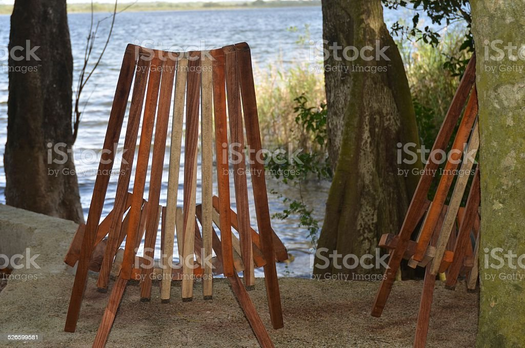 Deck Chairs with View of Water at Lamanai royalty-free stock photo