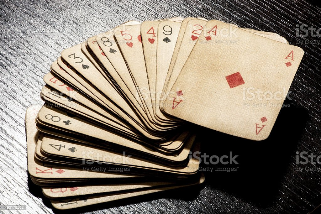 Deck of grungy dirty old playing cards stock photo