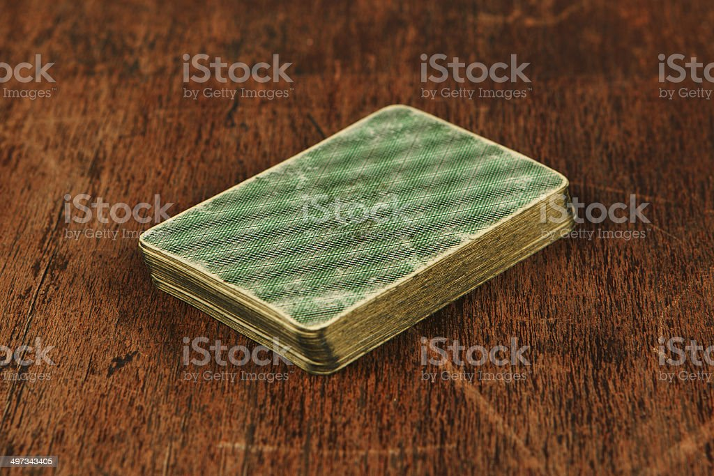 deck of old cards on wooden table stock photo