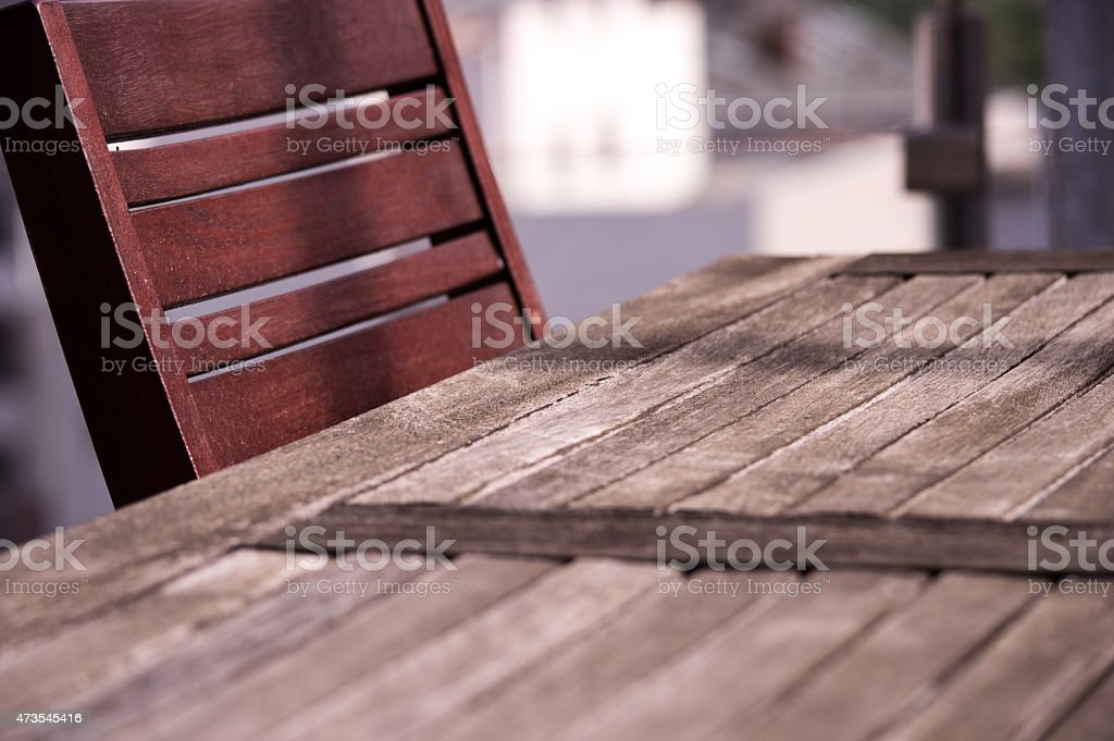 Deck Table and Chairs on a Balcony Outdoors royalty-free stock photo