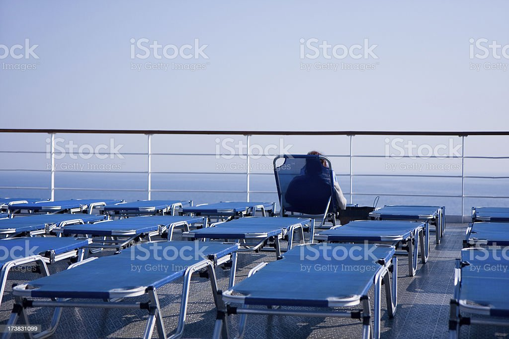deck with blue sun beds stock photo