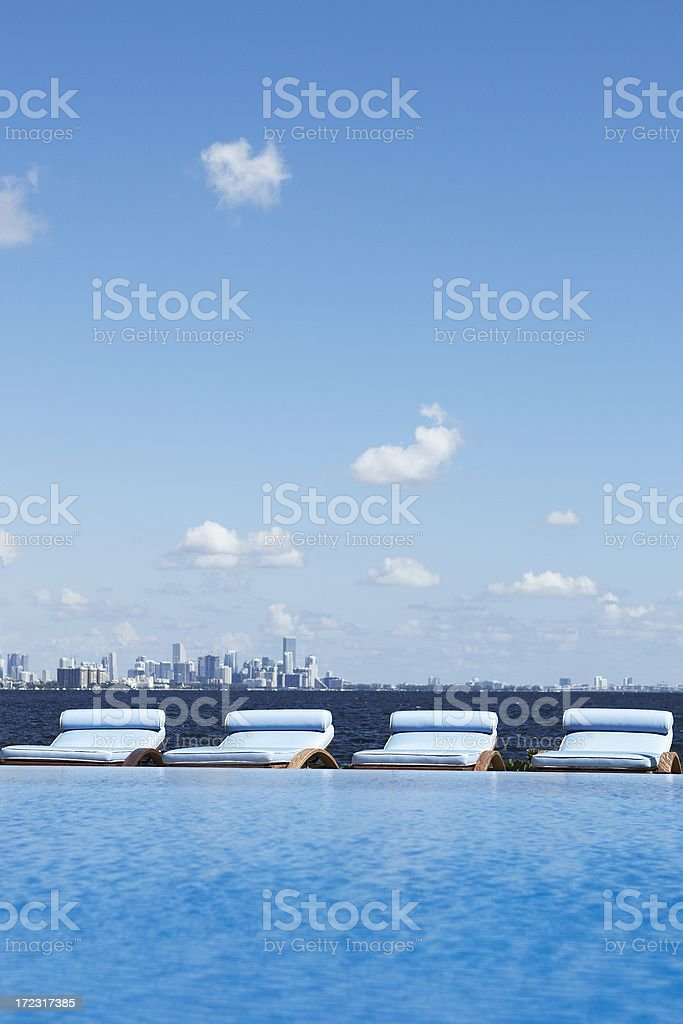 deckchairs and infinity pool royalty-free stock photo