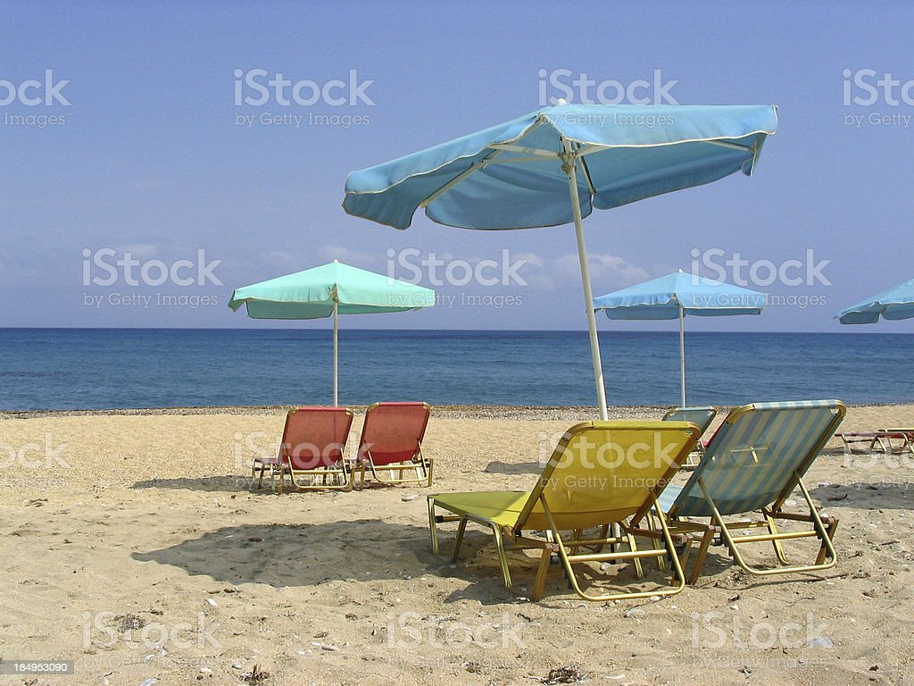 Deckchairs and parasols on a beach royalty-free stock photo