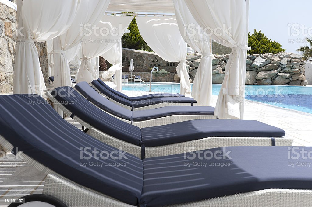 Deckchairs in a cabana stock photo