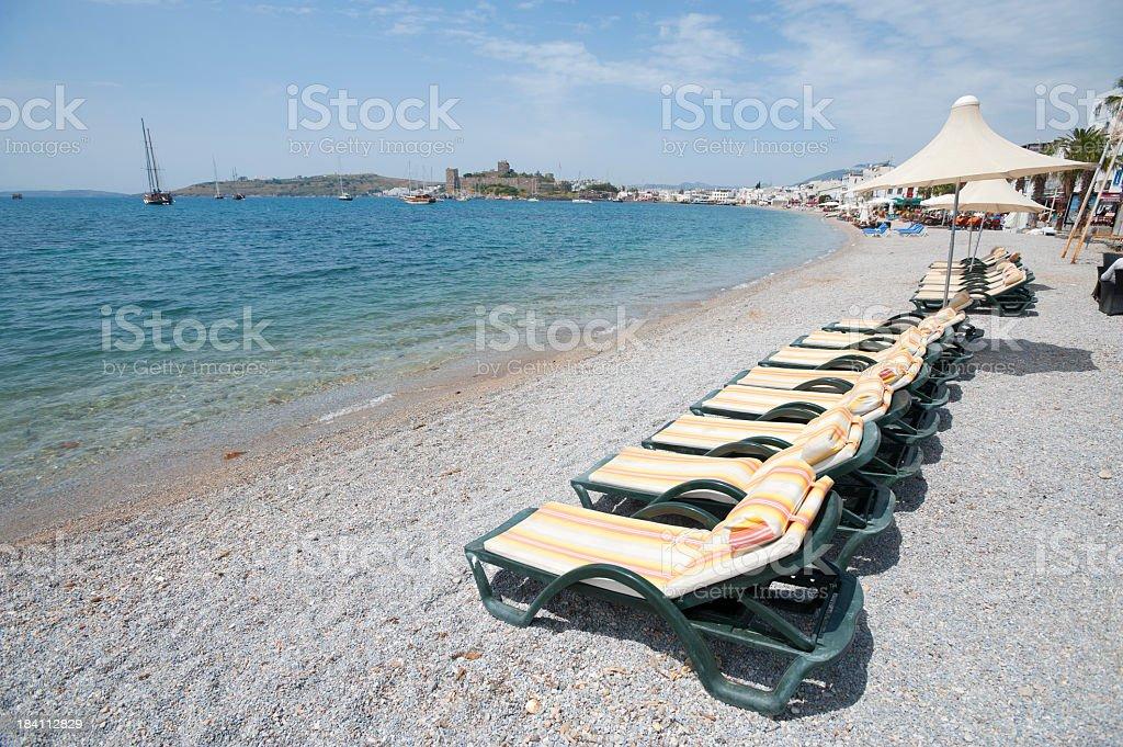 Deckchairs on a beach stock photo
