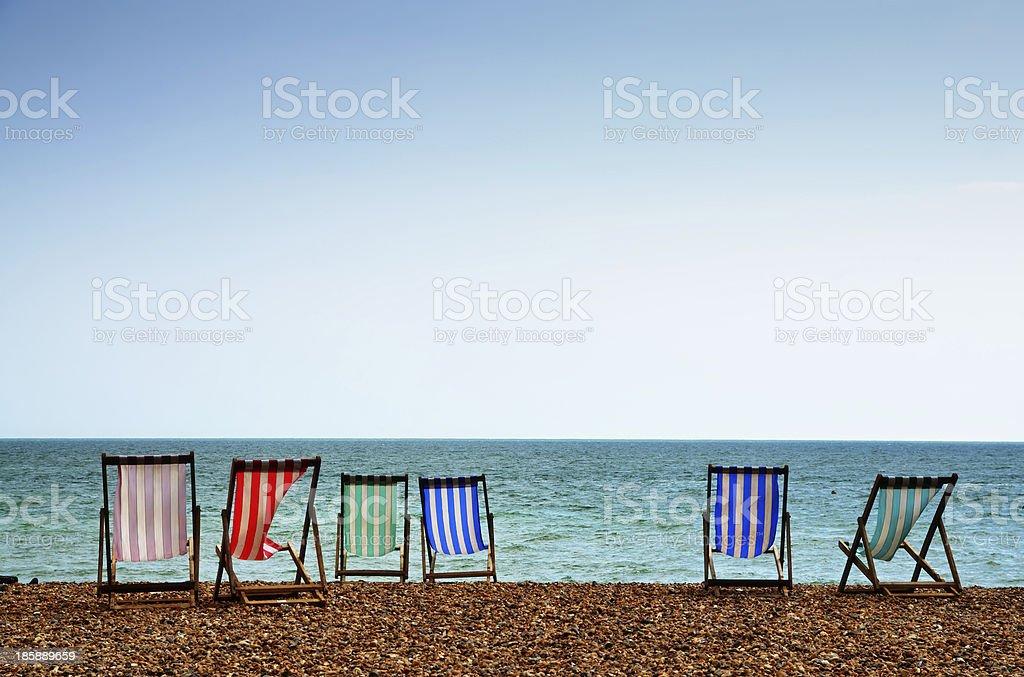 Deckchairs on Brighton Beach stock photo