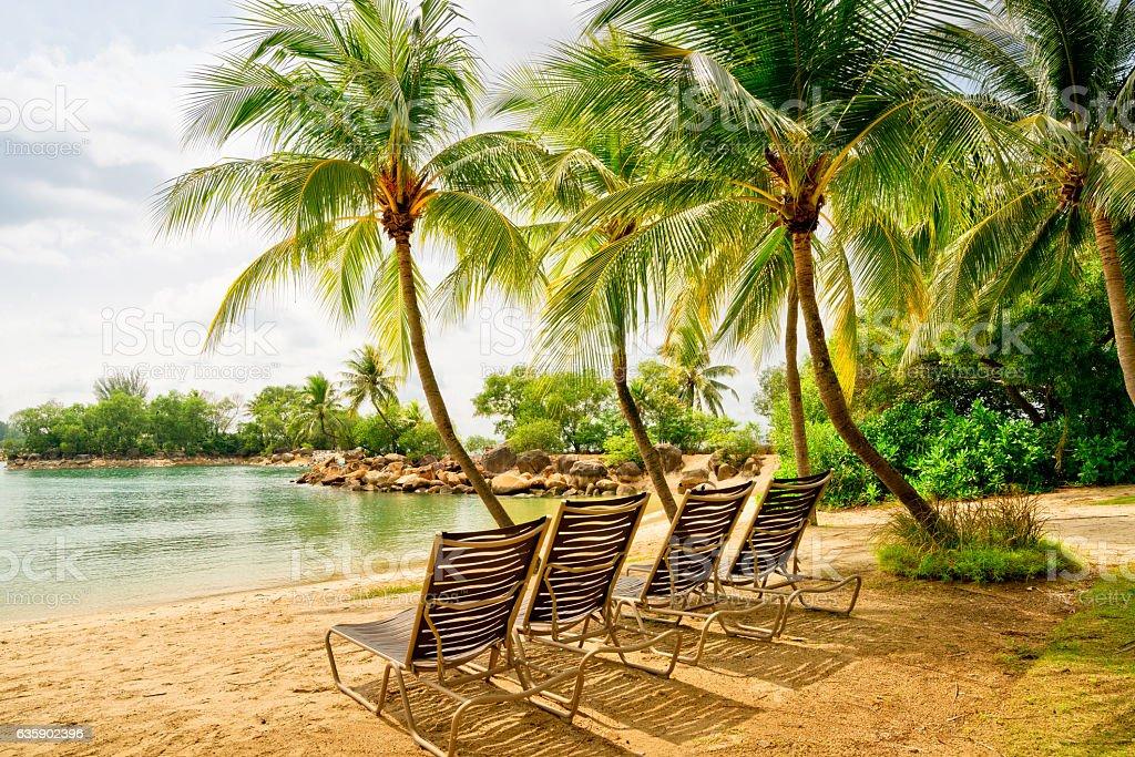 deckchairs on Sentosa Island Beach, Singapore stock photo