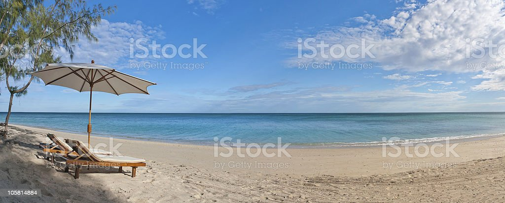Deckchairs on the beach royalty-free stock photo