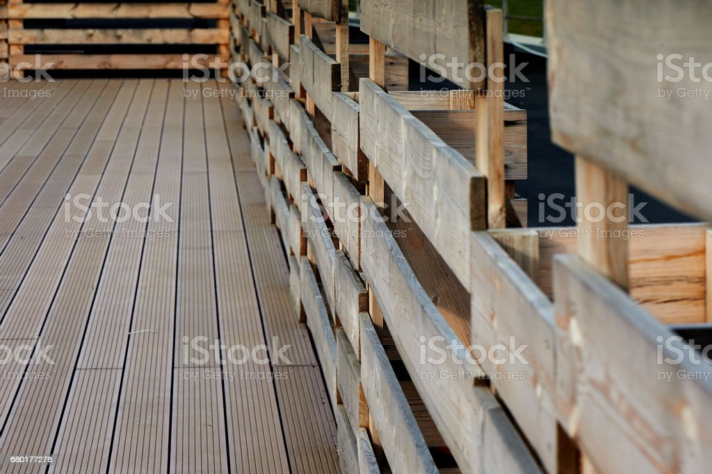 Decking and fence on a flat roof, against the sky, the forest and field stock photo