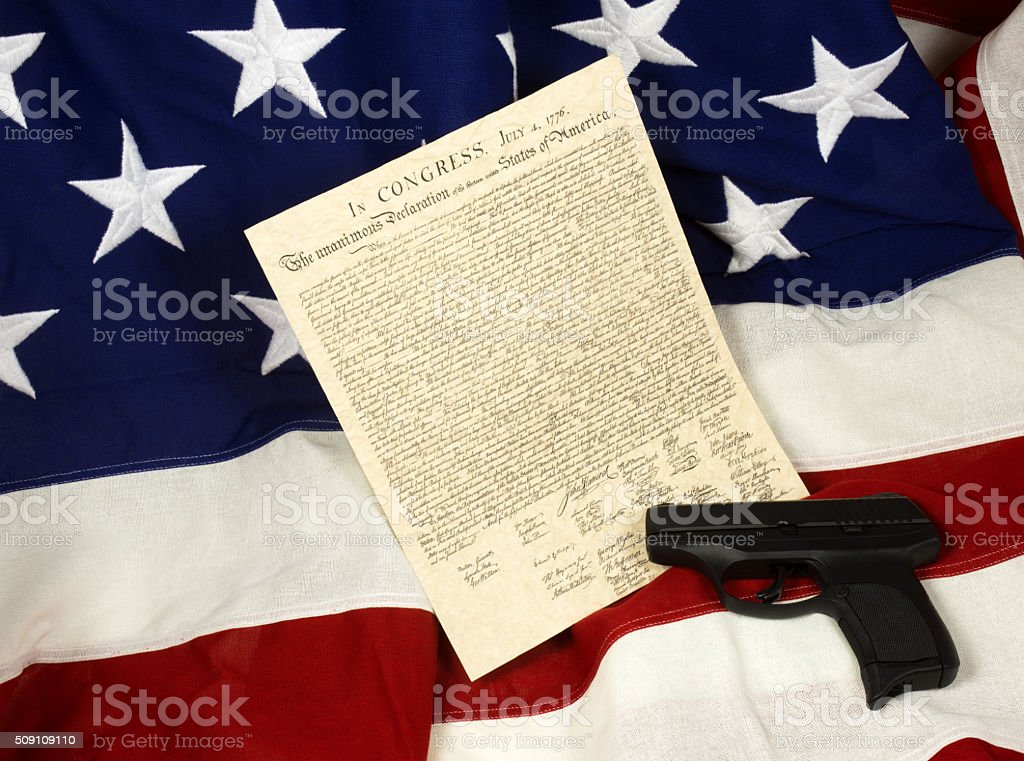 Declaration of Independence with Hand Gun on Flag, Horizontal stock photo