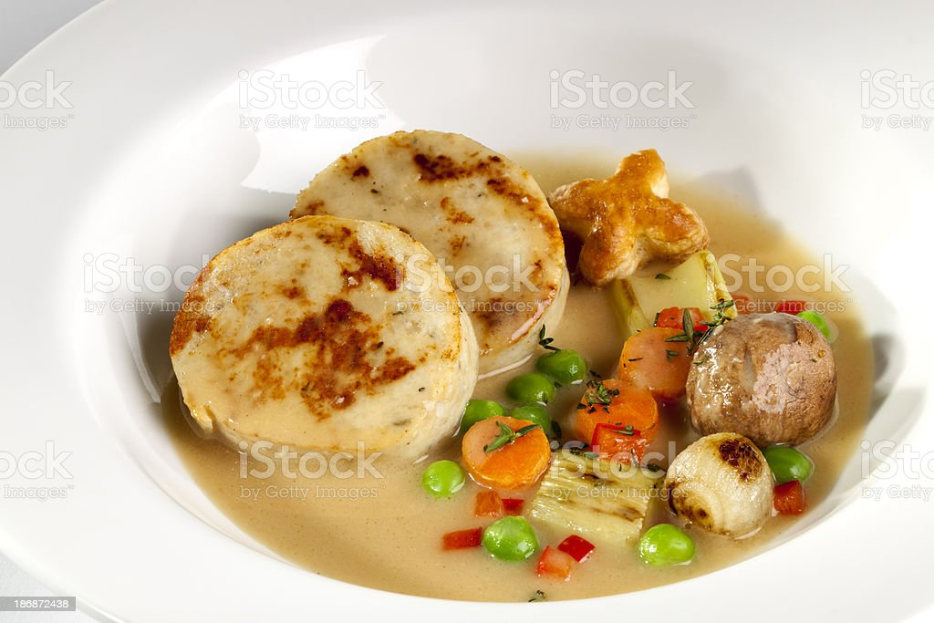 Deconstructed Chicken Pot Pie in a White Bowl stock photo
