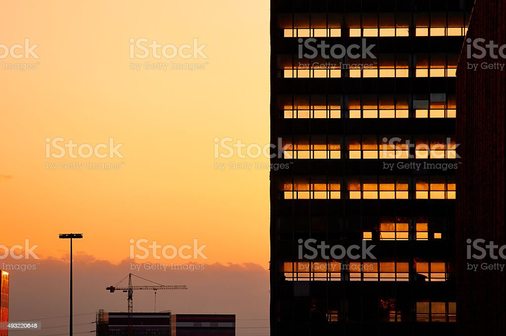 Decontruction of old office building. Sunset light in background. stock photo