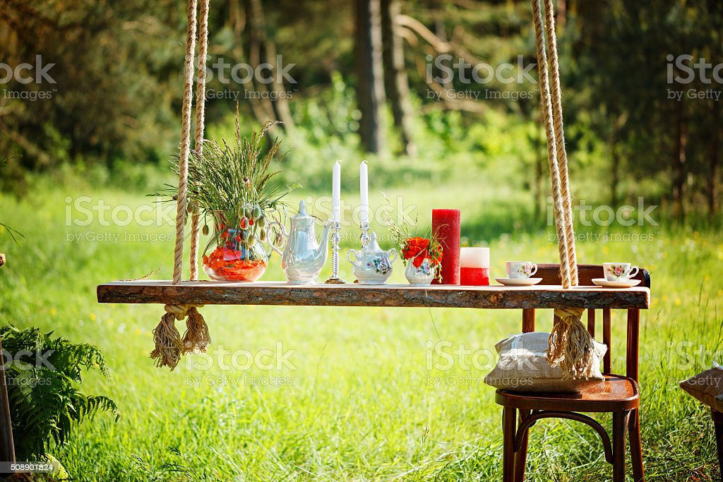 Decor Romantic dinner with  candles,flowers in green forest stock photo