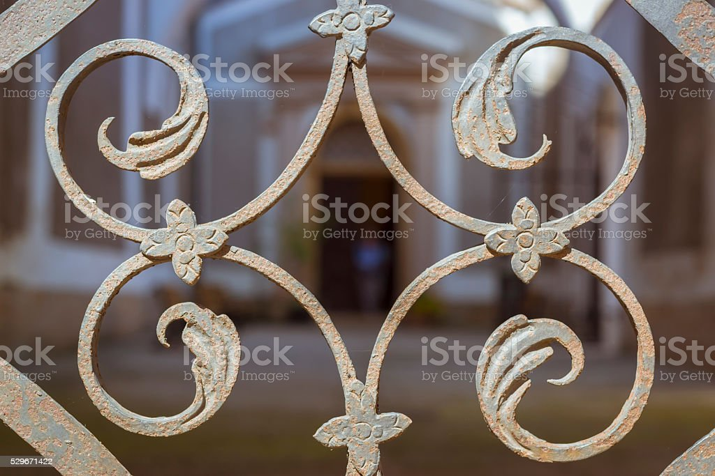 Decor wrought-iron lattice gate in form of leaves of plant stock photo
