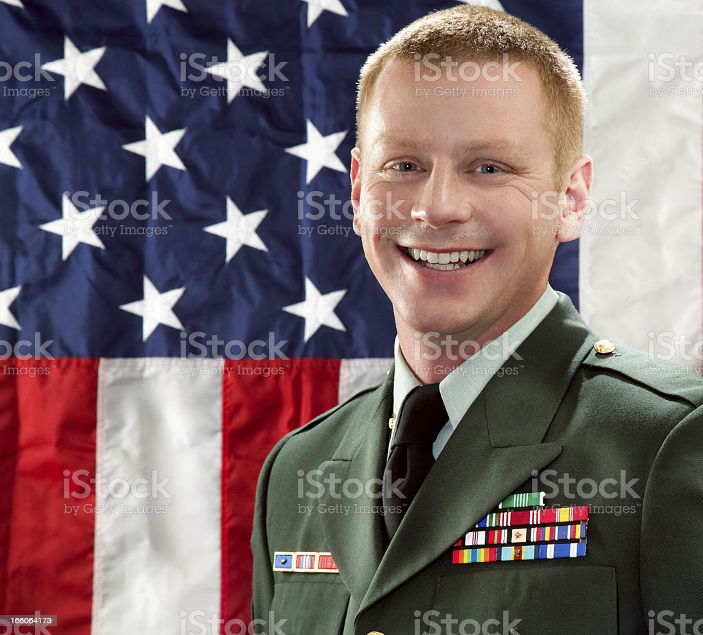 Decorated American Soldier with Class A Uniform Against USA Flag royalty-free stock photo